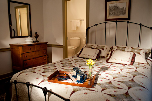 Queen size bed with private bath at the historic Jean Bonnet Tavern, Bedford, PA