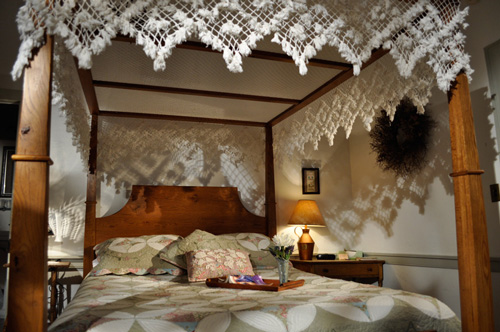 Hand knotted lace canopy over queen size bed at the Jean Bonnet B&B, Bedford, PA