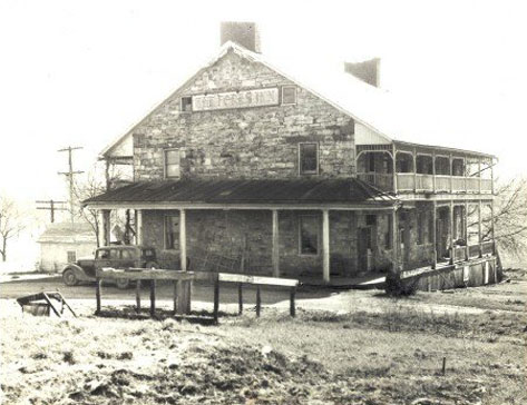 Early photo of Jean Bonnet Tavern with old car in fore, Bedford PA