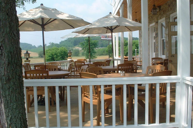 View of Dining Tables on Jean Bonnet Porch